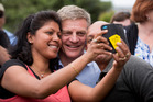 Prime Minister Bill English took selfies with the crowd as he attended his first Big Gay Out. Photo / Dean Ourcell