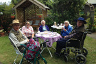 TEA PARTY: Hosts (left front) Graham and Elizabeth Juden with Masonic Court residents Margaret Wallis, Martha Hanlon and Roger Caseley. PHOTO/SUPPLIED