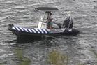 Searcher on Lake Rotoiti on Sunday. PHOTO/BEN FRASER