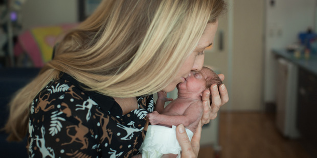 Katie Salter kissses her prematurely born baby Daisy Salter. Photo / Supplied