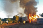 An accidental fire destroys a Showground Rd, Paengaroa family homestead. Photo/George Novak.