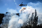Fire fighters and helicopters fight the blaze on the Port Hills Christchurch around Osterholts Rd, Tai Tapu. Christchurch Star photo / Martin Hunter