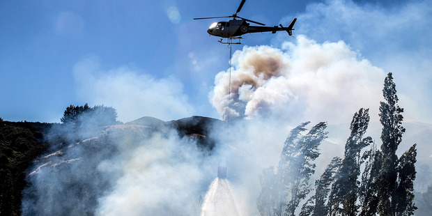 Loading Fire fighters and helicopters fight the blaze on the Port Hills Christchurch around Osterholts Rd, Tai Tapu. Christchurch Star photo / Martin Hunter