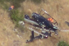 Wreckage of a helicopter crashed in the Port Hills. Photo / Supplied