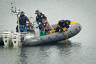 Divers during the search today. PHOTO/STEPHEN PARKER