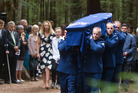 The body of Detective Steve Allpress is carried out of his funeral. PHOTO/STEPHEN PARKER