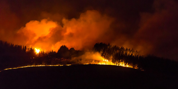 Loading Fire rips through the Port Hills illuminating the night sky. Photo / Peter Walkmer