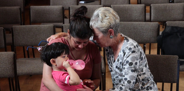 Loading Unitarian Church member Betsy Marshall (right) consoles Asha Rani, who faces deportation with her two-year-old daughter Khwahish because of immigration fraud. Photo / Brett Phibbs