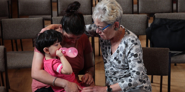 Loading A woman is consoled by a supporter at the Auckland Unitarian Church in Ponsonby after one of the Indian students facing deportation was arrested earlier this morning. Photo / Brett Phibbs