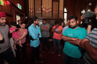 The Indian students who have received deportation orders wait at the Auckland Unitarian Church in Ponsonby after one of the students was arrested earlier this morning. 15 February 2017 New Zealan