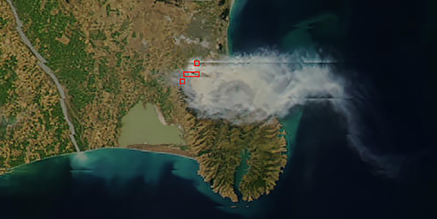 Smoke from the Port Hills Fires can be seen from space. Picture / NASA