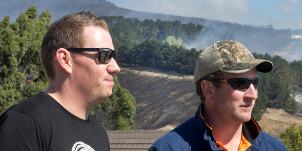 Loading Simon Grace (left), with Hamish Tovey, at a site overlooking the remains of his family home. Photo / Alan Gibson