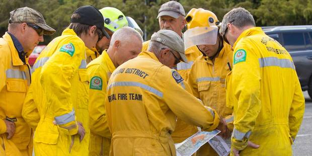 Fire crews discuss a plan of attack in fighting the Christchurch fires in the Port Hills. Photo / Supplied via @Christchurch City Council