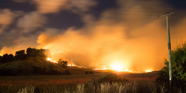 Fires rage in the Port Hills last night. Photo / Oliver Watson