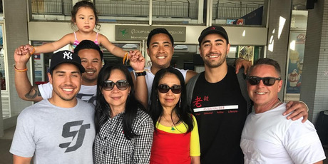 Warriors star Shaun Johnson and family at Laos airport. Photo / Supplied via Instagram
