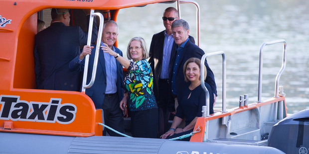 Australian Prime Minister Malcolm Turnbull and his wife Lucy and Prime Minister Bill English, his wife, Dr Mary English on their water taxi in Queenstown. Photo / Mark Mitchell