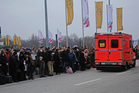 Travellers wait outside Hamburg airport after several people were injured what is believed to be pepper spray. Photo / AP