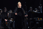 Adele as she performs her tribute to George Michael at the Grammy Awards. Photo/AP