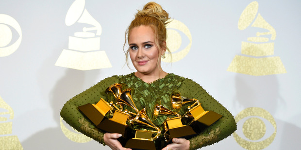 Adele poses in the press room with the awards for album of the year, song of the year, record of the year and best, best pop solo performance and best vocal album. Photo / AP