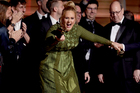 Adele holds the broken pieces of her Grammy - half for her, half for Beyonce. Photo / AP