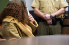 Gabriele P. sits in the courtroom in Munich Germany, on trial for allegedly killing her boyfriend in 2008. Photo / AP