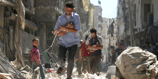 This photo by Ameer Alhalbi of Syrian men carrying babies through the rubble of Aleppo won second prize in the Spot News, Stories, category of the World Press Photo contest. Photo / AP