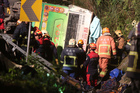 Members of rescue team at the scene where a bus collided with a car on a highway in Taipei, Taiwan. Photo / AP