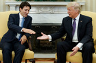 President Donald Trump reaches to shake hands with Canadian Prime Minister Justin Trudeau. Photo / AP