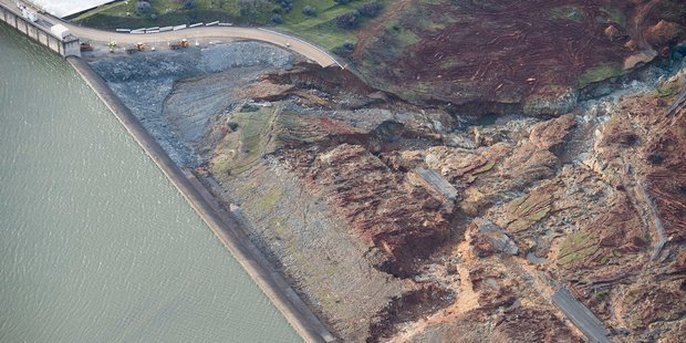 Aerial photos of the emergency spillway at Lake Oroville shows signs of damage from the water which spilled over recently. Photo / AP