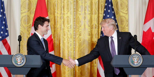 President Donald Trump and Canadian Prime Minister Justin Trudeau shake hands during a joint news conference in the East Room of the White House in Washington. Photo / AP