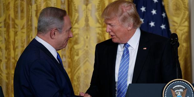 US President Donald Trump shakes hands with Israeli Prime Minister Benjamin Netanyahu. Photo / AP