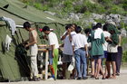 Men shave, brush their teeth and prepare for the day at a refugee camp on the Island of Nauru. Photo / AP