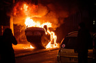 A car burns after a demonstration in Bobigny outside Paris. Photo / AP