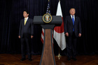President Donald Trump, right, and Japanese Prime Minister Shinzo Abe, left, listen to the translator after they both made statements. Photo / AP