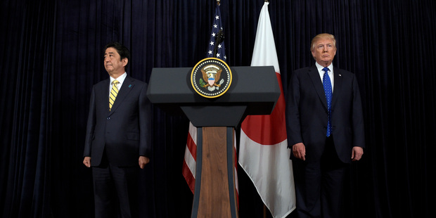 Loading President Donald Trump, right, and Japanese Prime Minister Shinzo Abe, left, listen to the translator after they both made statements. Photo / AP