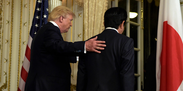 President Donald Trump, left, and Japanese Prime Minister Shinzo Abe, right, leave the room after making statements about the North Korean missile launch. Photo / AP