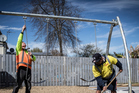 Workmen install new swings at Delphine Reserve in Auckland. Photo / Michael Craig