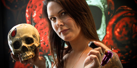 """Emma Kerr, tattoo artist said """"To be the only female in the shop is a real selling point, as I can offer something different to the guys.""""  Photo/Andrew Warner"""