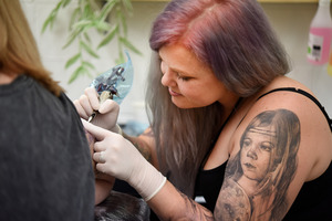 Skye Carson-Wilson, a butterfly tattoo inked on her hip was where Skye's passion for tattoo art began. Photo/George Novak