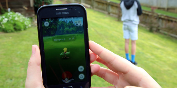 Dangerous play? Playing Pokemon Go can lead to injuries. Photo / Stuart Munro