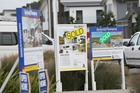 House for sale sign in Auckland. 14 July 2015 New Zealand Herald Photograph by Chris Loufte NZH 13Aug15 - NZH 24Jun16 - Auckland has the most-leveraged homes in the country. Picture / Ch