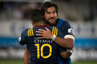 Blues no.8 Steven Luatua embraces Highlanders 1st5 Lima Sopoaga after the opening match of 2016 Super Rugby season. Photo / Jason Oxenham.