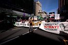 Protest down Queen St, Auckland, over the government's TPPA trade deal. Photo / Dean Purcell