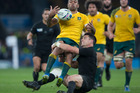 All Blacks first-five Daniel Carter tackles Australian Kurtley Beale during the 2015 Rugby World Cup Final. Photo/Brett Phibbs