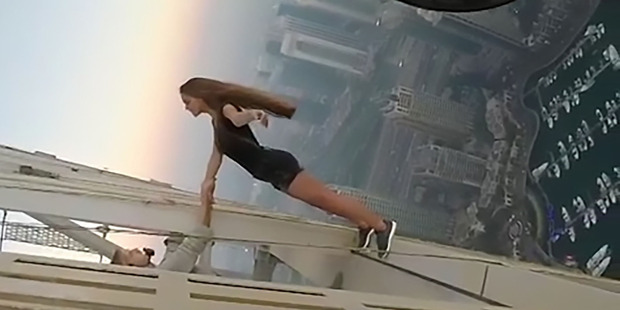Viki Odintcova posed for the death-defying photoshoot on top of one of the world's tallest skyscrapers. Photo / Australscope