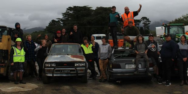 Tararua District mayor Tracey Collis (front left) pictured among just some of the delighted throng who turned up to enjoy the burnout action.