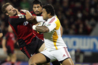 Sione Lauaki fends off Richie McCaw during the Super 14 match between the Crusaders and the Chiefs. Photo/Photosport