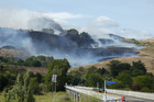 After crossing the Waimarama Rd bridge over the Tukituki River John Wuts said looking back seeing a house burn was distressing. Photo / John Wuts