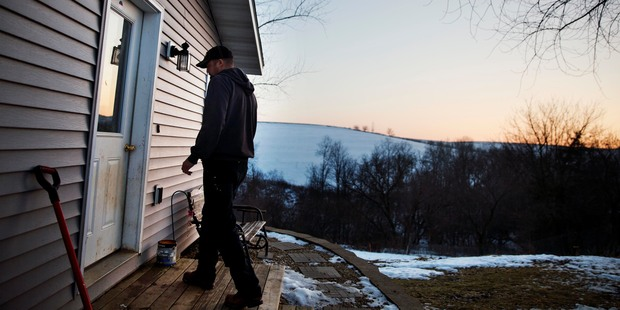 Jeff McCullick walks into his home in Ferryville, Wis. Photo / AP
