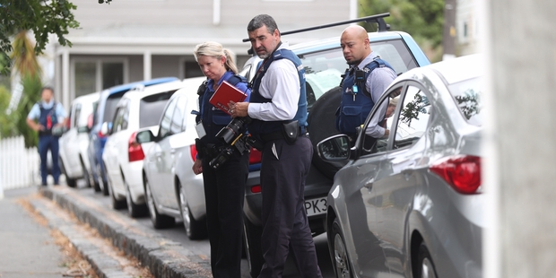 Loading Officers investigate the scene at Copeland St where a woman jumped from a car. Photo / Jason Oxenham